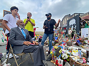 6/24/21  James Meredith sits in front of Cups Food where George Food was murdered and speaks with members of the community who are in charge on maintaining the George Floyd Memorial Square.  Civil Rights maverick, and Mississippi's Native son, James Meredith visits George Floyd Memorial Square the day before ex police officer Eric Chauvin is sentenced for the murder of George Floyd.  Meredith is in Minnesota for More Than A Moment, a series of roundtable discussions with students, educators, lawyers, and community leaders and faith leaders to discuss ways to end racism and how to build strong community leaders. Meredith emphasized the importance of speaking the truth and working together to make change for the better in our communities. Photo © Suzi Altman 6/24/21 James Meredith poses outside Cup Foods in front of the George Floyd memorial mural, Meredith says he was the George Floyd of his time. The site where Floyd was brutally killed by ex police officer Eric Chauvin who will be sentenced for the murder Friday June 25th. Civil rights icon James Meredith visits George Floyd Memorial Square the day before ex police officer Derek Chauvin is sentenced for the murder of George Floyd. Meredith is in Minnesota for More Than A Moment, a series of roundtable discussions with students, educators, lawyers, and community leaders and faith leaders to discuss ways to end racism and how to build strong community leaders. Meredith emphasized the importance of speaking the truth and working together to make change for the better in our communities. Photo © Suzi Altman #jamesmeredith #georgefloyd #minneapolis #minnesota #justice #peace #mural #memorial #education #suzialtman #shotoniphone #derekchauvin #murder #blacklivesmatter photo copyright © @suzialtman  #derekchauvin