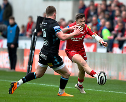 Scarlets' Steff Evans threads one past Glasgow Warriors' Stuart Hogg<br /> <br /> Photographer Simon King/Replay Images<br /> <br /> Guinness PRO14 Round 19 - Scarlets v Glasgow Warriors - Saturday 7th April 2018 - Parc Y Scarlets - Llanelli<br /> <br /> World Copyright © Replay Images . All rights reserved. info@replayimages.co.uk - http://replayimages.co.uk