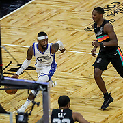 ORLANDO, FL - APRIL 12: Terrence Ross #31 of the Orlando Magic speeds past Lonnie Walker IV #1 of the San Antonio Spurs during the second half at Amway Center on April 12, 2021 in Orlando, Florida. NOTE TO USER: User expressly acknowledges and agrees that, by downloading and or using this photograph, User is consenting to the terms and conditions of the Getty Images License Agreement. (Photo by Alex Menendez/Getty Images)*** Local Caption *** Terrence Ross; Lonnie Walker IV