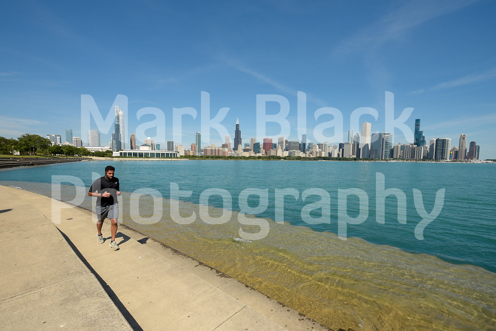 Jogger along the Chicago lakefront in Chicago, Illinois.<br /> Photo by Mark Black