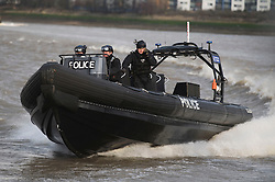 © Licensed to London News Pictures. 19/01/2012. London, UK. A Metropolitan Police boat takes part in a joint Scotland Yard and Royal Marines  rehearsal exercise for Olympics security on the River Thames at Woolwich Arsenal Pier, London on January 19, 2012. Photo credit : Ben Cawthra/LNP