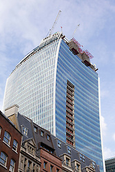© Licensed to London News Pictures. 03/09/2013. London, UK. The 'Walky Talkie' building, also known as 20 Fenchurch Street, is seen in London today (03/09/2013). The building, still under construction, has hit headlines after it was found that, due to it's curved architecture, light reflected from the building at certain times of the day was melting cars and has the ability to cook eggs. Photo credit: Matt Cetti-Roberts/LNP