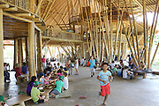 """""""Heart of School"""" during lunchbreak<br /><br />The Green School (Bali) is one of a kind in Indonesia. It is a private, kindergarten to secondary International school located along the Ayung River near Ubud, Bali, Indonesia. The school buildings are of ecologically-sustainable design made primarily of bamboo, also using local grass and mud walls. There are over 600 students coming from over 40 countries with a percentage of scholarships for local Indonesian students.<br /><br />The impressive three-domed """"Heart of School Building"""" is 60 metres long and uses 2500 bamboo poles. The school also utilizes renewable building materials for some of its other needs, and almost everything, even the desks, chairs, some of the clothes and football goal posts are made of bamboo.<br /><br />The educational focus is on ecological sustainability. Subjects taught include English, mathematics and science, including ecology, the environment and sustainability, as well as the creative arts, global perspectives and environmental management. This educational establishment is unlike other international schools in Indonesia. <br /><br />Renewable energy sources, including solar power and hydroelectric vortex, provide over 50% of the energy needs of the school. The school has an organic permaculture system and prepares students to become stewards of the environment. <br /><br />The school was founded by John and Cynthia Hardy in 2008."""