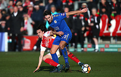 Fleetwood Town's Markus Schwabi (left) and Leicester City's Matty James battle for the ball during the FA Cup, third round match at Highbury Stadium, Fleetwood