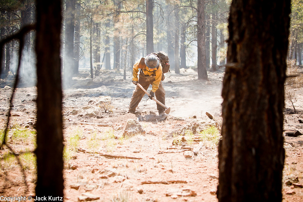 22 JUNE 2010 - FLAGSTAFF, AZ: Robert Smith CQ, from the Groveland Hot Shots (CQ) on the line at the Schultz Fire burning north of Flagstaff, AZ. The fire has consumed more than 12,000 acres of forest land and burned within a few feet of homes in some neighborhoods in Flagstaff.   PHOTO BY JACK KURTZ