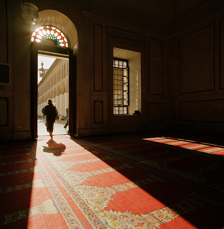 Worshipper at the Umayyad Mosque, the Grand Mosque of Damascus, in Damascus, Syria
