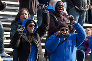 Newburgh, New York - Middletown fans cheer for their team during the Orange County Youth Football League Division II Super Bowl at Newburgh Free Academy on Nov. 22, 2014.
