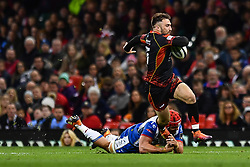 27th April 2019 , Principality Stadium , Cardiff, Wales ; Guinness pro 14's, Round 21, Dragons vs Scarlets ; Jordan Williams of Dragons evades the tackle of Josh Macleod of Scarlets<br /> <br /> Credit :  Craig Thomas/Replay Images