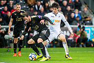 ( L-R ) Christian Fuchs of Leicester City and Ki Sung-Yueng of Swansea City in action. Premier league match, Swansea city v Leicester city at the Liberty Stadium in Swansea, South Wales on Saturday 21st October 2017.<br /> pic by Aled Llywelyn, Andrew Orchard sports photography.