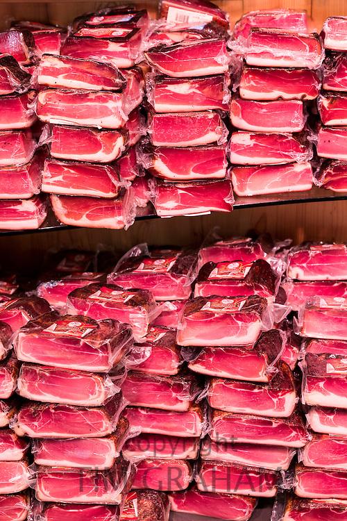 Traditional Tyrolean speck cured meat in Handl Tyrol shop in Herzog Friedrich Strasse in Innsbruck in the Tyrol, Austria
