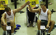 © Peter Spurrier/Sports Photo +44 (0) 7973 819 551.PPP Healthcare British Indoor Rowing Championships.18th Nov. 2001.National Indoor Arena..Matthew Pinsent (L) joins hand with his rowing partner James Craacknell, after he won [Pinsent] the British Indoor Rowing Championships at Birmingham in the final few sscc's of the race... ........... [Mandatory Credit: Peter SPURRIER/Intersport Images]<br /> <br /> 20011118 British Indoor Rowing Championships, Birmingham.