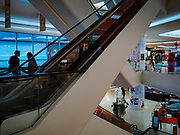 15 DECEMBER 2018 - BANGKOK, THAILAND:  Shoppers on an escalator in Central Embassy, an upscale mall in central Bangkok. According to Credit Suisse Global Wealth Databook 2018, which surveyed 40 countries, Thailand has the highest rate of income inequality in the world. In 2016, Thailand was third, behind Russia and India. In 2016, the 1% richest Thais (about 500,000 people) owned 58.0% of the Thailand's wealth. In 2018, they controlled 66.9%. In Russia, those numbers went from 78% in 2016, down to 57.1% in 2018. The Thai government disagreed with the report and said the report didn't take government anti-poverty programs into account and that Thailand was held to an unfair standard because most of the other countries in the report are developed countries in the Organisation for Economic Co-operation and Development.     PHOTO BY JACK KURTZ