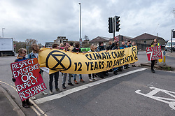 © Licensed to London News Pictures. 16/03/2019. Bristol, UK. Participants stage a non violent direct action road block outside the Extinction Rebellion (XR) Spring Uprising training weekend at Motion nightclub in Bristol, an event in preparation for the International Rebellion on April 15th. Speakers at the event included Satish Kumar and XR groups held workshops and trained in non-violent direct action to create disruption and cause change. The event it also to celebrate and strengthen the movement, and get skilled up and organised for the International Rebellion on April 15th. Photo credit: Simon Chapman/LNP