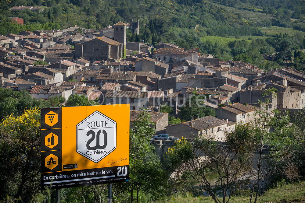 Aerial landscape overlooking the pretty French medieval walled village of Lagrasse incl the Church of Saint-Michel on the River Orbieu, on 23rd May, 2017, in Lagrasse, Languedoc-Rousillon, south of France. Lagrasse is listed as one of Frances most beautiful villages and lies on the famous Route 20 wine route in the Basses-Corbieres region dating to the 13th century.