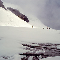 Sherpas practice crevasse safety on the Dzongla Glacier at an early mountaineering school for sherpas in the Khumbu region of Nepal, 1980.