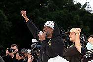 Rodney Overby former Sydney King Basketball player puts his fist in the air at Hyde Park during a 'Black Lives Matter' rally on 02 June, 2020 in Sydney, Australia. This event was organised to rally against aboriginal deaths in custody in Australia as well as in unity with protests across the United States following the killing of an unarmed black man George Floyd at the hands of a police officer in Minneapolis, Minnesota. (Photo by Steven Markham/ Speed Media)