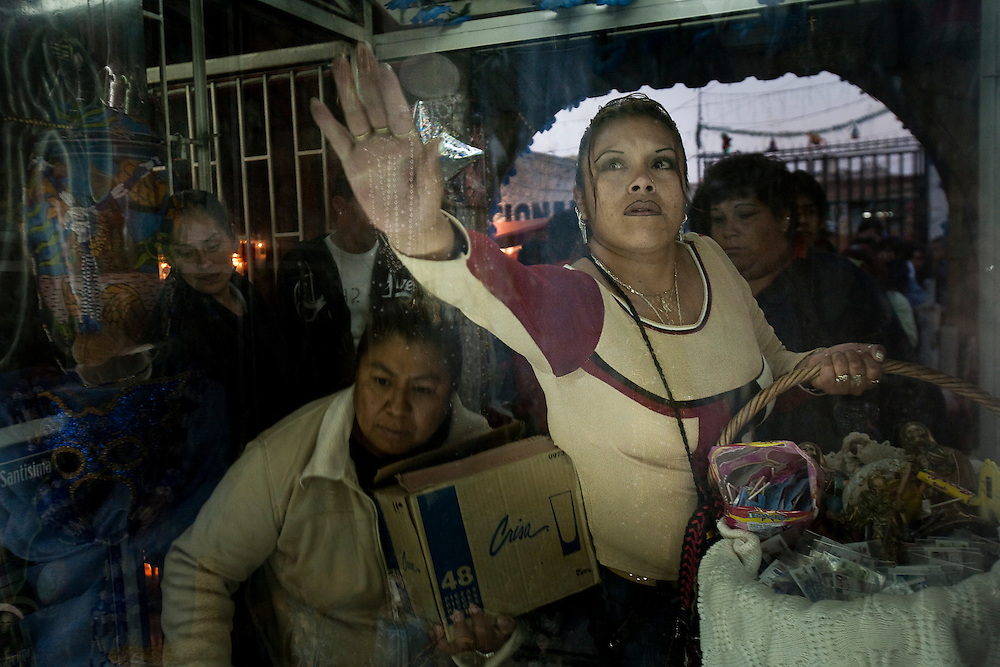 Sante Muerte devotees line up to pay respect during a Rosary ceremony at a popular shrine in Tipito in Mexico City.