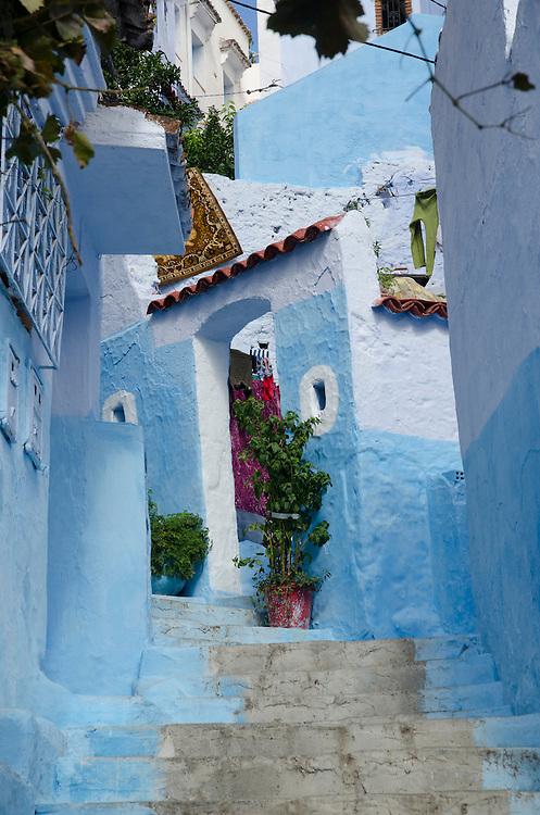 A narrow alley in Chefchaouen's medina, Morocco
