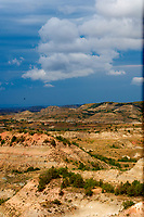 Painted Canyon Panorama. Theodore Roosevelt National Park. Image taken with a Nikon D3 and 85 mm f/2.8 PC-E lens (ISO 200, 85 mm, f/16, 1/40 sec). 7 of 9 images combined with AutoPano Giga and Dehaze Filter.
