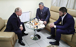 October 11, 2018 - Ulyanovsk, Russia - 10 October 2018. Vladimir Putin met with Russian wrestler, UFC lightweight champion Habib Nurmagomedov. The head of state congratulated the fighter on winning the competition. The meeting was attended by the father and coach of the athlete Abdulmanal Nurmagomedov. Photo: Kremlin Pool (Credit Image: © Russian Look via ZUMA Wire)