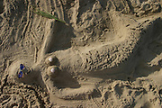 Mermaid sand sculpture on the beach at Martha's Vineyard, Massachusetts. MODEL RELEASED.