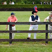 3 gentlemen discuss the days events in between races during the Queens Cup 2012.