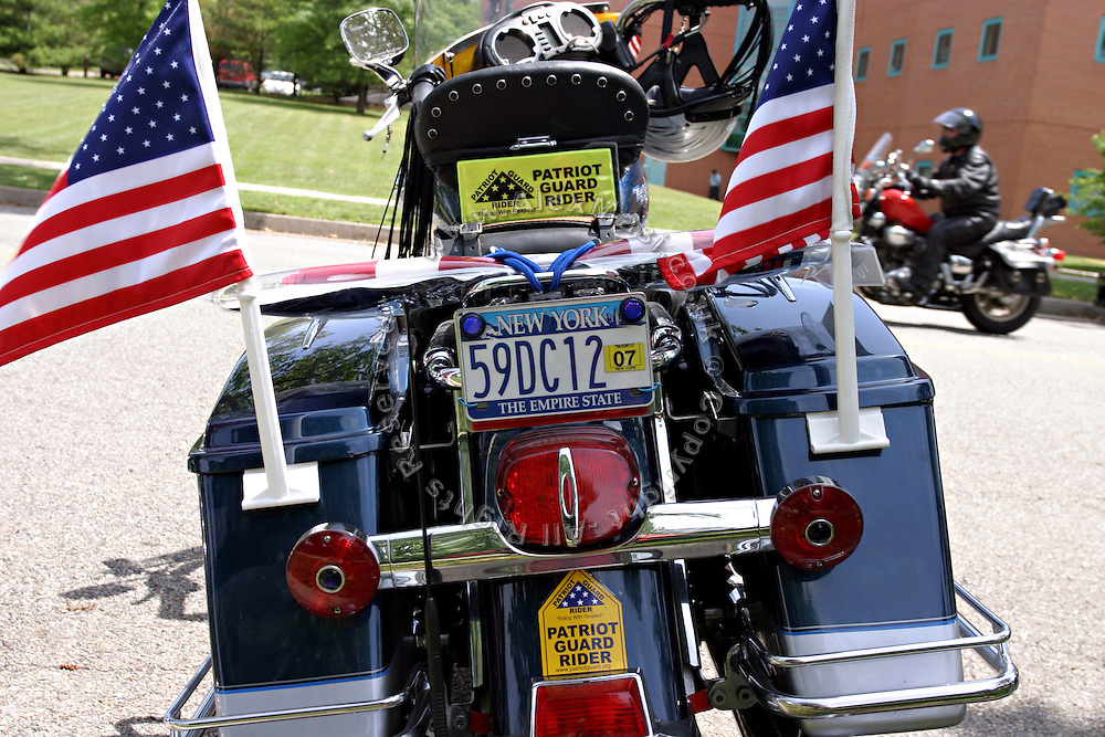 One of the bikes belonging to a member of the Patriot Guard Rider just outside church where the funeral service of Sgt. Ian T. Sanchez will take place, in Staten Island, NY., on Tuesday, June 27, 2006. Sgt. Sanchez, a 26-year-old American serviceman was killed by a roadside bomb in the Pech River Valley, Afghanistan. The Patriot Guard Riders is a diverse amalgamation of riders from across the United States of America. Besides a passion for motorcycling, they all have in common an unwavering respect for those who risk their lives for the country's freedom and security. They are an American patriotic group, mainly but not only, composed by veterans from all over the United States. They work in unison, calling upon tens of different motorcycle groups, connected by an internet-based web where each of them can find out where and when a 'Mission' is called upon, and have the chance to take part. This way, the Patriot Guard Riders can cover the whole of the United States without having to ride from town to town but, by organising into different State Groups, each with its own State Captain, they are still able to maintain strictly firm guidelines, and to honour the same basic principles that moves the group from the its inception. The main aim of the Patriot Guard Riders is to attend the funeral services of fallen American servicemen, defined as 'Heroes' by the group,  as invited guests of the family. These so-called 'Missions' they undertake have two basic objectives in particular: to show their sincere respect for the US 'Fallen Heroes', their families, and their communities, and to shield the mourners from interruptions created by any group of protestors. Additionally the Patriot Guard Riders provide support to the veteran community and their families, in collaboration with the other veteran service organizations already working in the field.   **ITALY OUT**