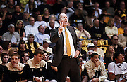 SHOT 1/21/12 5:37:11 PM - Colorado head basketball coach Tad Boyle coaches against Arizona during their PAC 12 regular season men's basketball game at the Coors Events Center in Boulder, Co. Colorado won the game 64-63..(Photo by Marc Piscotty / © 2012)