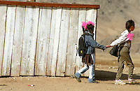 Two kids walking home after school in Jaragalant Somm (small Mongolian Village), Mongolia.