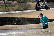 WILMINGTON, NC - MARCH 19: UNC Wilmington's Thomas Lilly hits out of a bunker on the Ocean Course seventh hole. The first round of the 2017 Seahawk Intercollegiate Men's Golf Tournament was held on March 19, 2017, at the Country Club of Landover Nicklaus Course in Wilmington, NC.