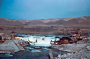 CS00364-02. Hand-pulled cable car moving toward Chinook rock at Celilo Falls, September 9, 1956.