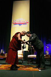 17 May 2013. New Orleans, Louisiana,  USA..Dr Richard Davidson of Tulane University hands a Tulane cap to His Holiness the 14th Dalai Lama in New Orleans for the 'Resiliance - Strength through Compassion and Connection' conference. .The Dalai Lama's shoes..Photo; Charlie Varley.