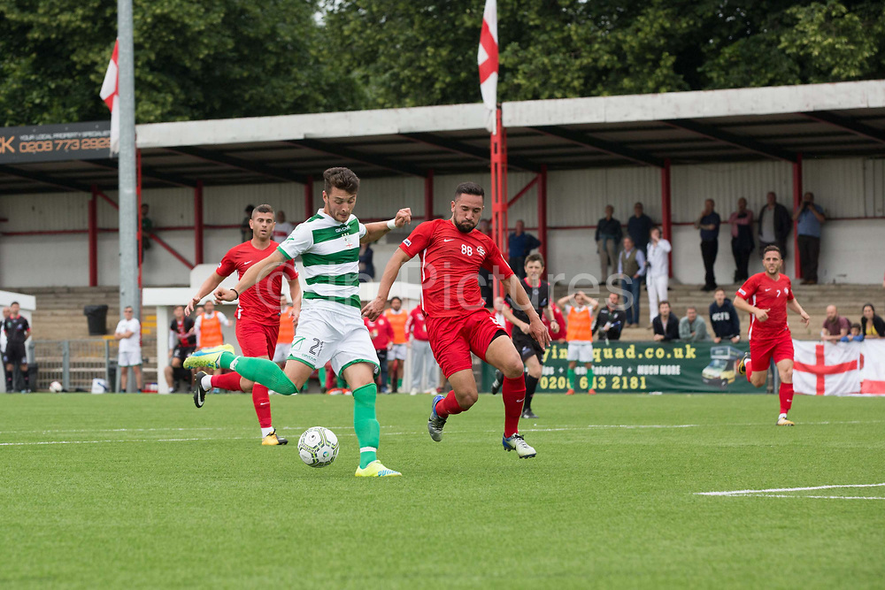 Riccardo Ravasi for Padania on the attack, with Adil Yalcin Ucar defending. Northern Cyprus 3 v Padania 2 during the Conifa Paddy Power World Football Cup semi finals on the 7th June 2018 at Carshalton Athletic Football Club in the United Kingdom. The CONIFA World Football Cup is an international football tournament organised by CONIFA, an umbrella association for states, minorities, stateless peoples and regions unaffiliated with FIFA.