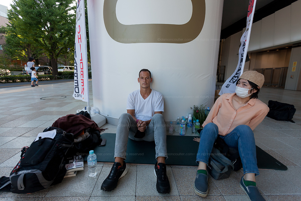 Portrait of Frenchmen, Vincent Fichot (left) on day seven of his hunger strike outside Sendagaya Station, Tokyo, Japan. Saturday July 17th 2021. Vincent Fichot has not seen his two children since they were abducted by his wife in 2018. He started a hunger strike to put pressure on French President, Emmanuel Macron, who will be attending the 2020 Tokyo Olympic opening ceremony, to raise the issue further with the Japanese government.