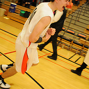 1/24/12 -- BRUNSWICK, Maine. Mitchell Black celebrates the win over Lawrence with a huge holler and a streak around the court. On his buzzer beating three-pointer Brunswick tied the game at 50 and then, together with his teammates, went on to win in overtime 56-54.  Photo by Roger S. Duncan.