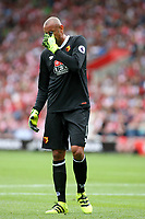 Football - 2016 / 2017 Premier League - Southampton vs. Watford<br /> Heurelho Gomes of Watford feels the pain after suffering an injury during the first half at St Mary's Stadium Southampton <br /> <br /> Colorsport/Shaun Boggust