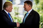 President Donald Trump greets Klaus Iohannis, Romania's president, as he arrives at the West Wing of the White House in Washington, District of Columbia, U.S., on Friday, June 9, 2017. Trump and Iohannis will discuss the 20-year-old strategic partnerships that the two countries have.