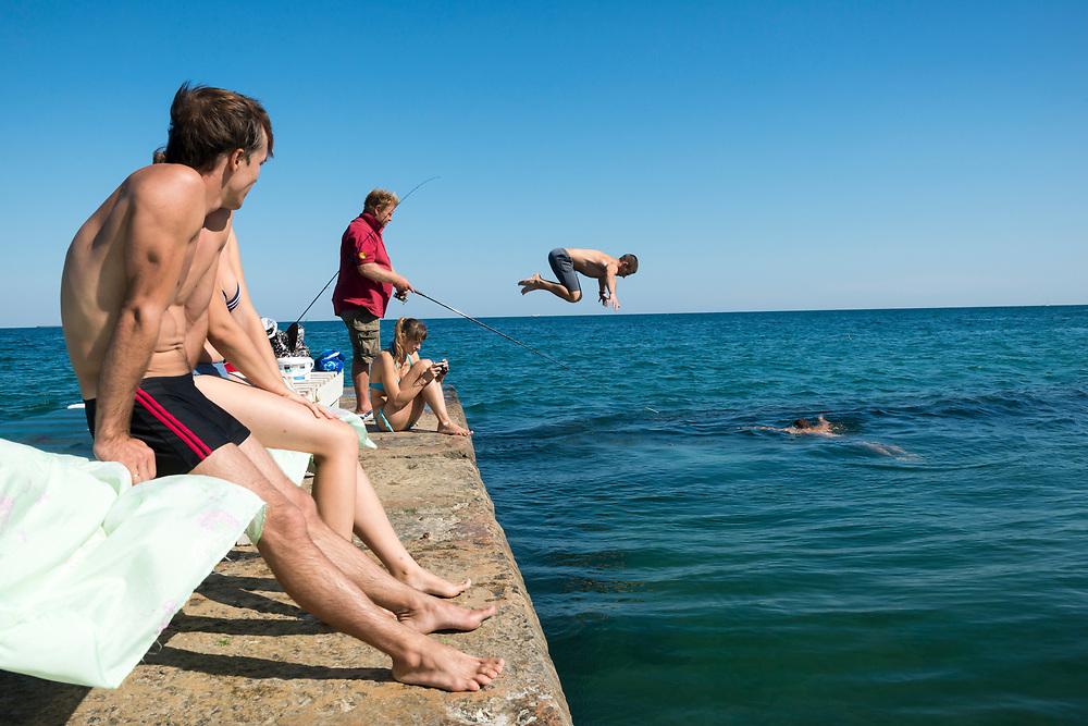 Ukrainians fish, swim, and sunbathe at the Black Sea in Odessa, Ukraine.<br /><br />(September 2016)