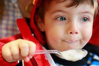 Joe, eating mousse from a café au lait, Paris
