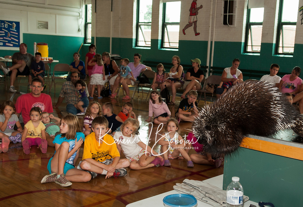 Laconia Library summer reading program with Squam Lakes Natural Science Center at the Community Center Wednesday August 1st.  (Karen Bobotas/for the Laconia Daily Sun)