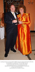 Leading business woman DAWN GIBBINS and her husband MR MARK GREAVES, at a reception in London on 24th April 2003.PJA 10