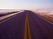 Open road on a frosty morning, Badlands National Park, South Dakota.