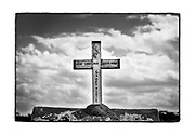 SHOT 2/21/19 1:41:40 PM - A small crumbling roadside capilla sporting a cross atop it outside of San Antonio C√°mara in the Yucatan Peninsula of Mexico. The capillas are often dedicated to certain patron saints or the memory of someone that has died at or near the site. Common throughout the backroads and secondary highways of Mexico they often contain prayer candles, pictures, personal artifacts or handwritten notes. (Photo by Marc Piscotty / © 2019)