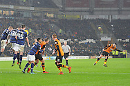 Hull City midfielder Robert Snodgrass takes free kick at goal deflected by Bolton Wanderers defender Robert Holding during the Sky Bet Championship match between Hull City and Bolton Wanderers at the KC Stadium, Kingston upon Hull, England on 12 December 2015. Photo by Ian Lyall.