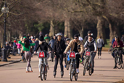 © Licensed to London News Pictures.21/02/2021. London, UK. Members of the public enjoy a walk, cycle or run in Hyde Park, central London. The weather forecasts predict that it will be the warmest weekend since November. Photo credit: Marcin Nowak/LNP