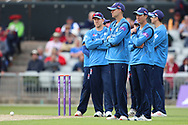 Derbyshires team look on at the injured Lancashires Liam Hurt during the Royal London 1 Day Cup match between Lancashire County Cricket Club and Derbyshire County Cricket Club at the Emirates, Old Trafford, Manchester, United Kingdom on 2 May 2019.