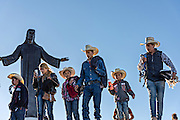A family of Mexican cowboys visit the Cristo Rey shrine on top Cubilete Mountain at the end of the annual Cabalgata de Cristo Rey pilgrimage January 6, 2017 in Guanajuato, Mexico. Thousands of Mexican cowboys take part in the three-day ride to the mountaintop shrine of Cristo Rey.
