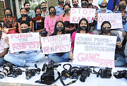 60388496  <br /> Photojournalists with their mouth tied with black cloth participate in a protest against the gang-rape of a female photojournalist in Gauhati, India, on Aug. 24, 2013. Mumbai's police on Saturday arrested a second man and said they had enough evidence to prosecute those responsible for a crime that has renewed public outcry over sexual violence in the country. A 22-year-old woman photographer was gang-raped by five men when she and her colleague were shooting pictures of a factory ruin in central Mumbai Thursday,  <br /> Picture by imago / i-Images<br /> UK ONLY