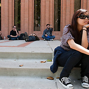 Extras wait for the call during production for the feature film The Roommate at the University of Southern California campus in Los Angeles.