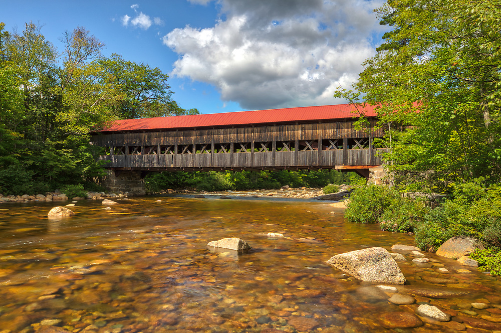 New England waterfall photography of the Albany Covered Bridge in the White Mountain National Forest of New Hampshire.<br /> <br /> New Hampshire White Mountain National Forest covered bridge fine art photography artworks are available as museum quality photography prints, canvas prints, acrylic prints, wood prints or metal prints. Fine art prints may be framed and matted to the individual liking and interior design decorating needs.<br /> <br /> Good light and happy photo making!<br /> <br /> My best,<br /> <br /> Juergen